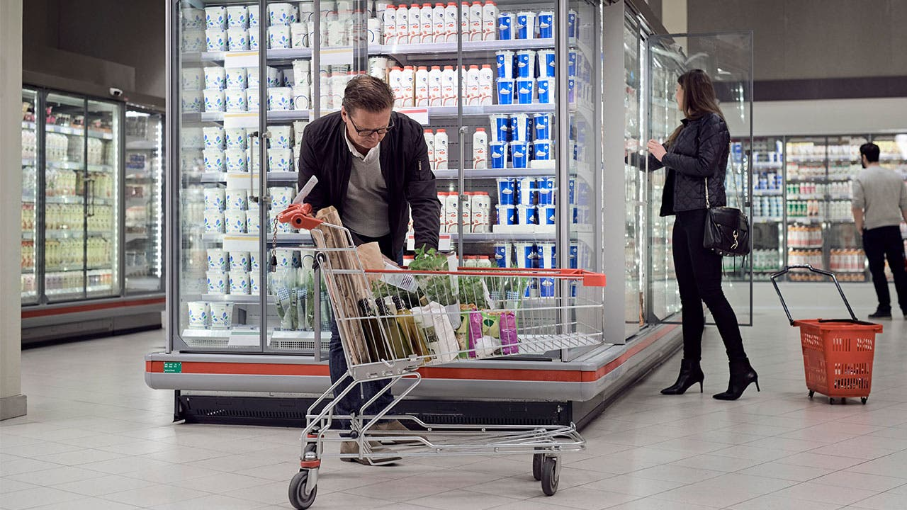 Man shopping at supermarket