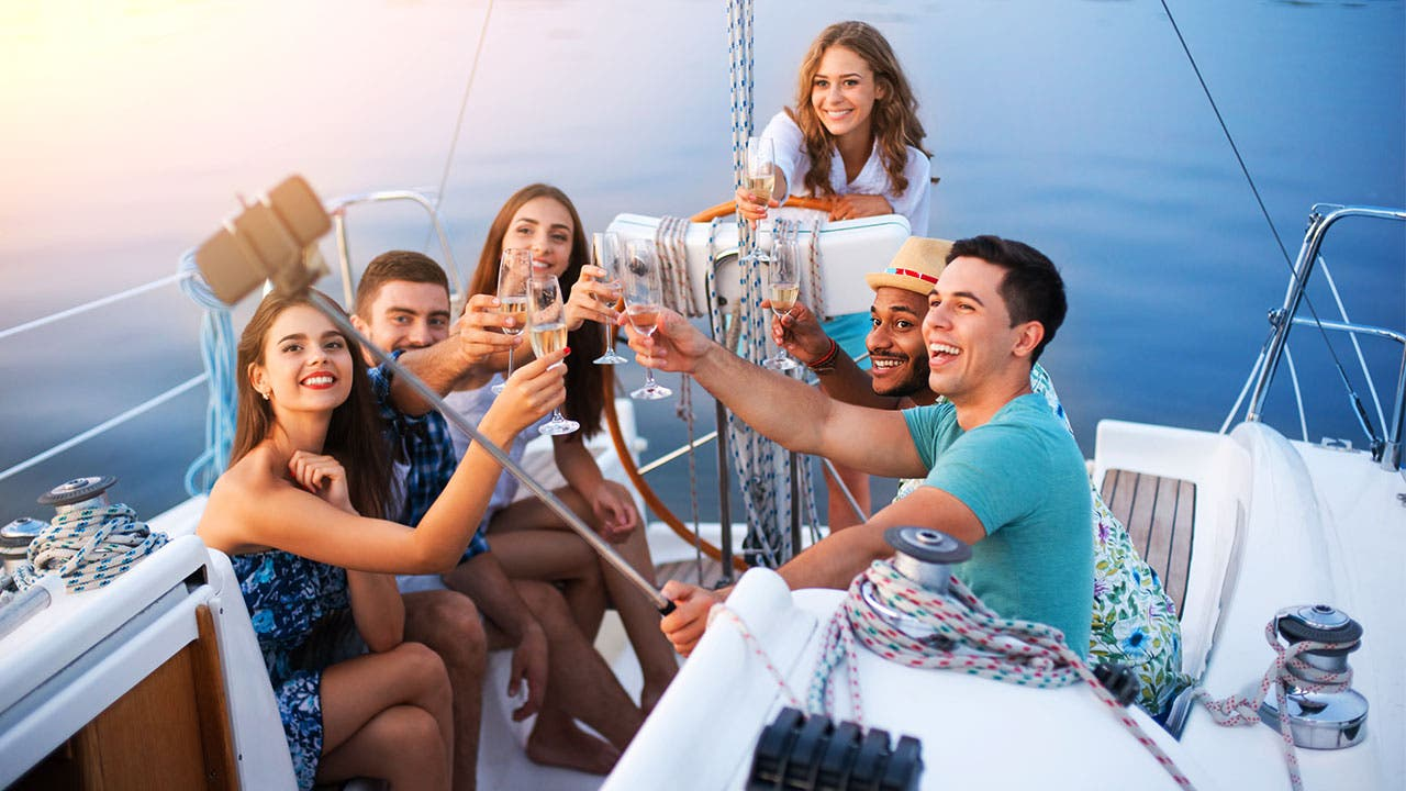 Friends toast on a yacht