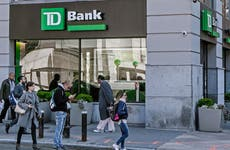 Pedestrians walking by TD Bank