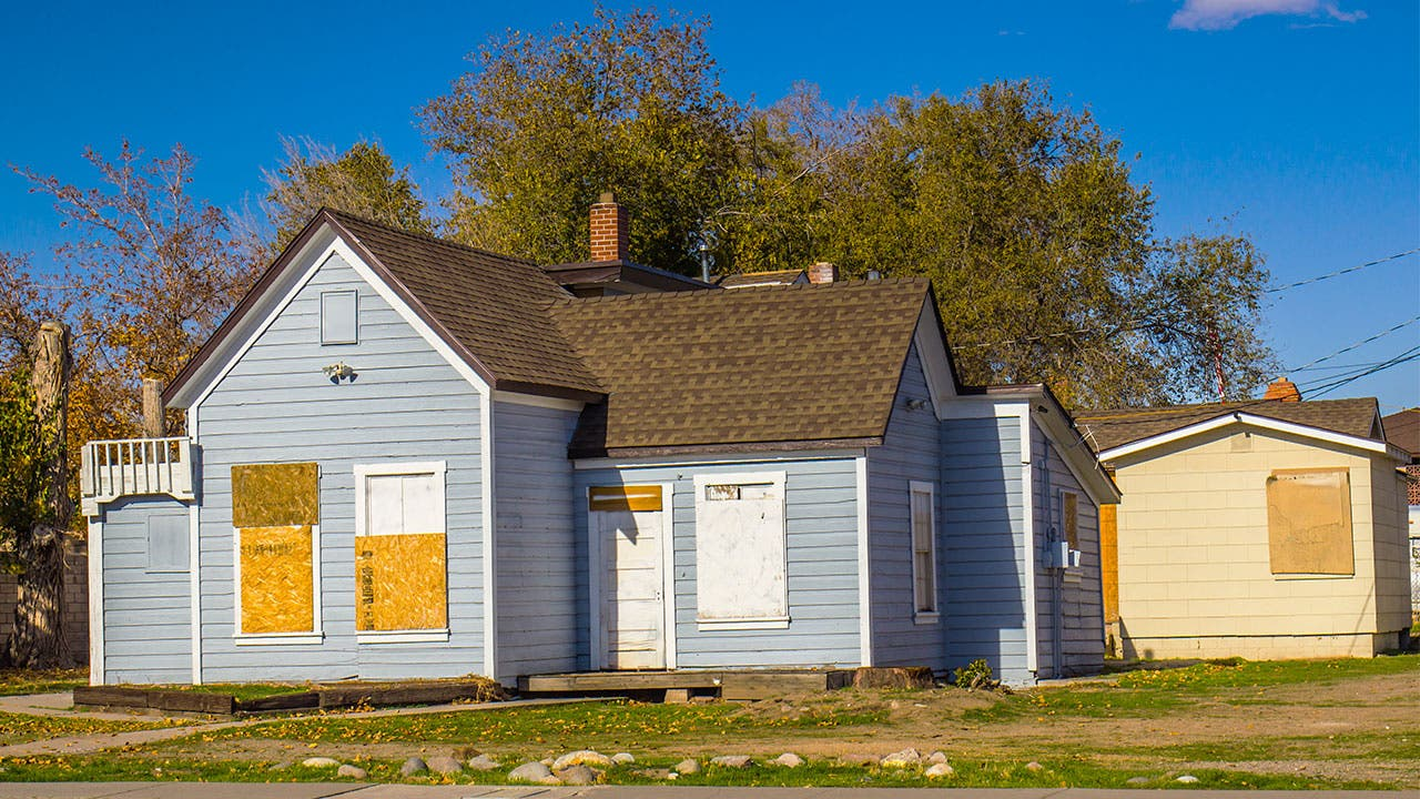 Boarded up foreclosed house