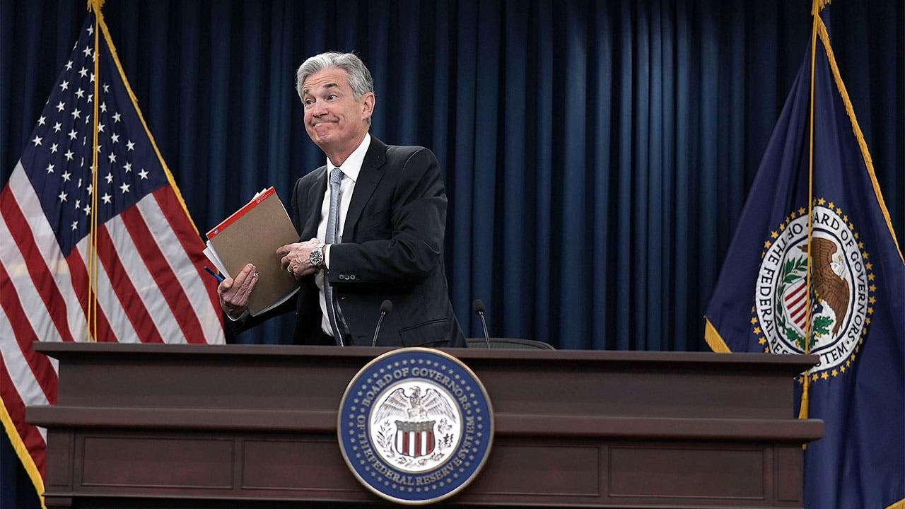 Jerome Powell leaves Fed meeting