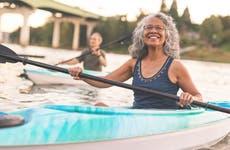 Seniors kayaking along a river