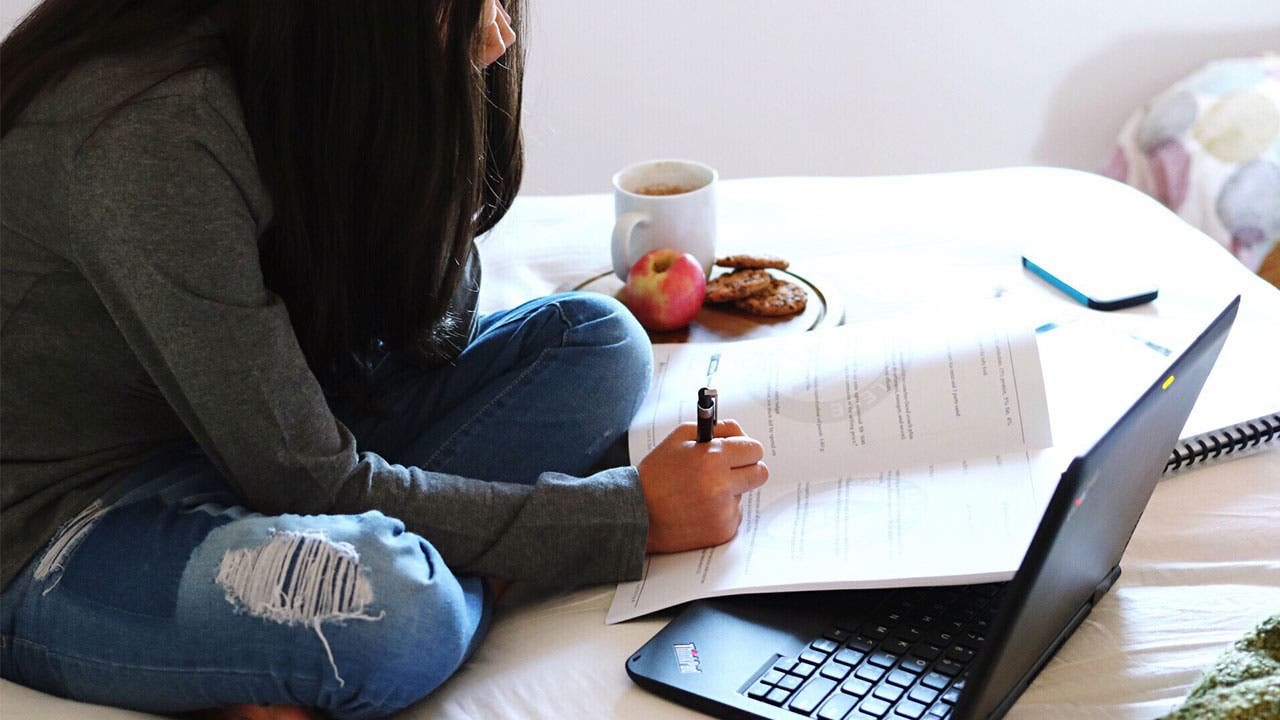 Student doing homework in dorm room