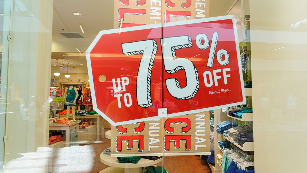 Clearance sale signs in store window