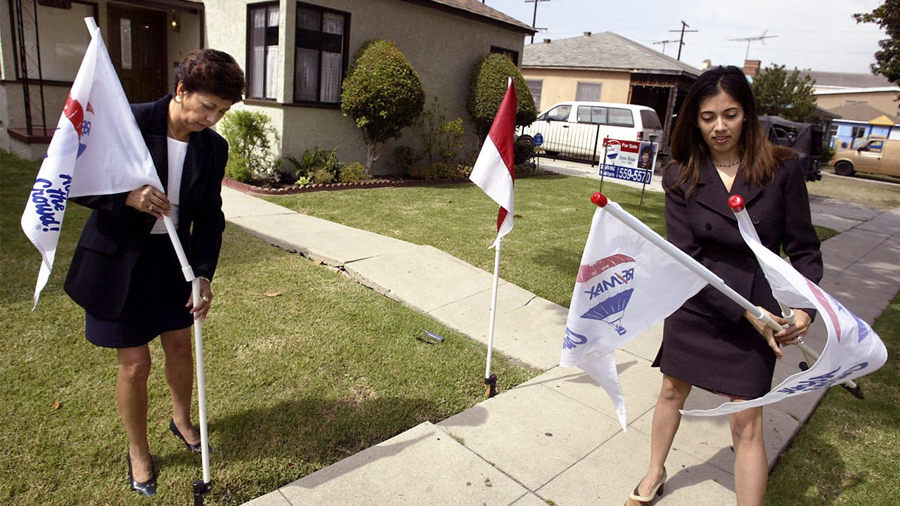 Real Estate agents set up flags