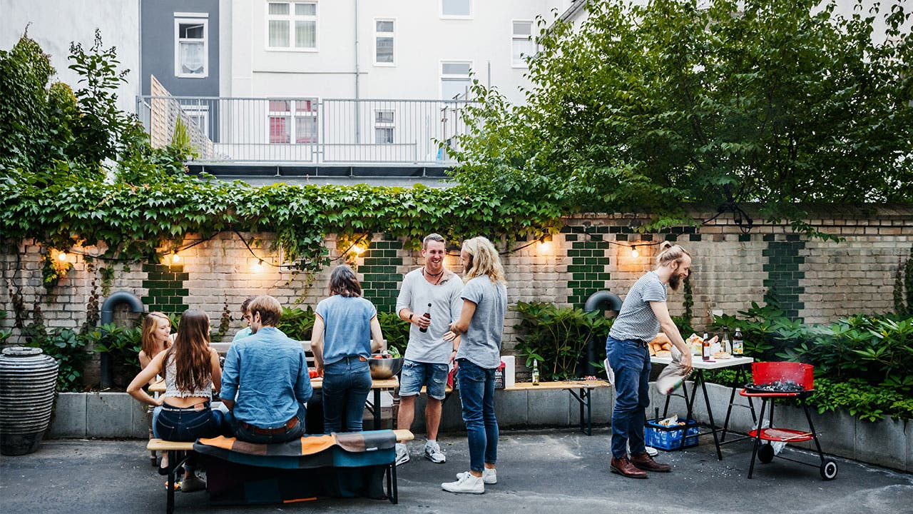 Millennials rooftop grilling party