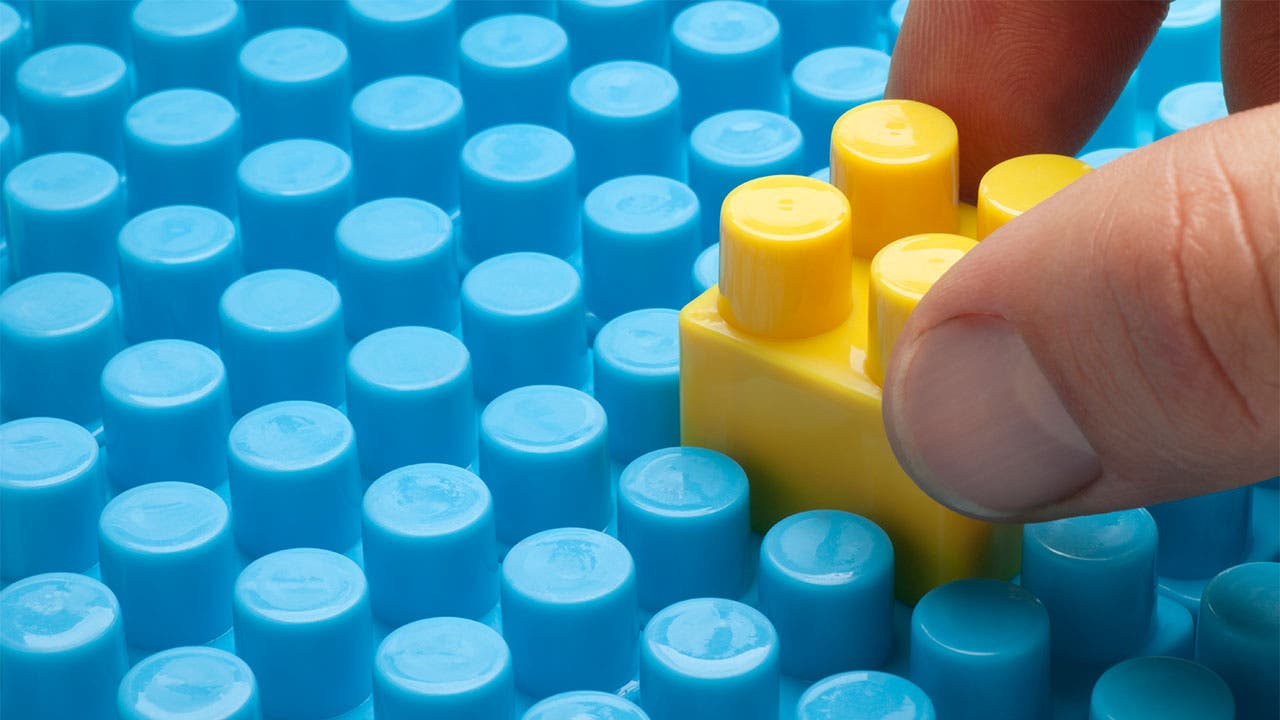 Man using lego blocks