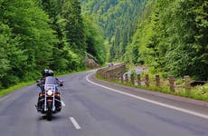 Couple motorcycling on the road