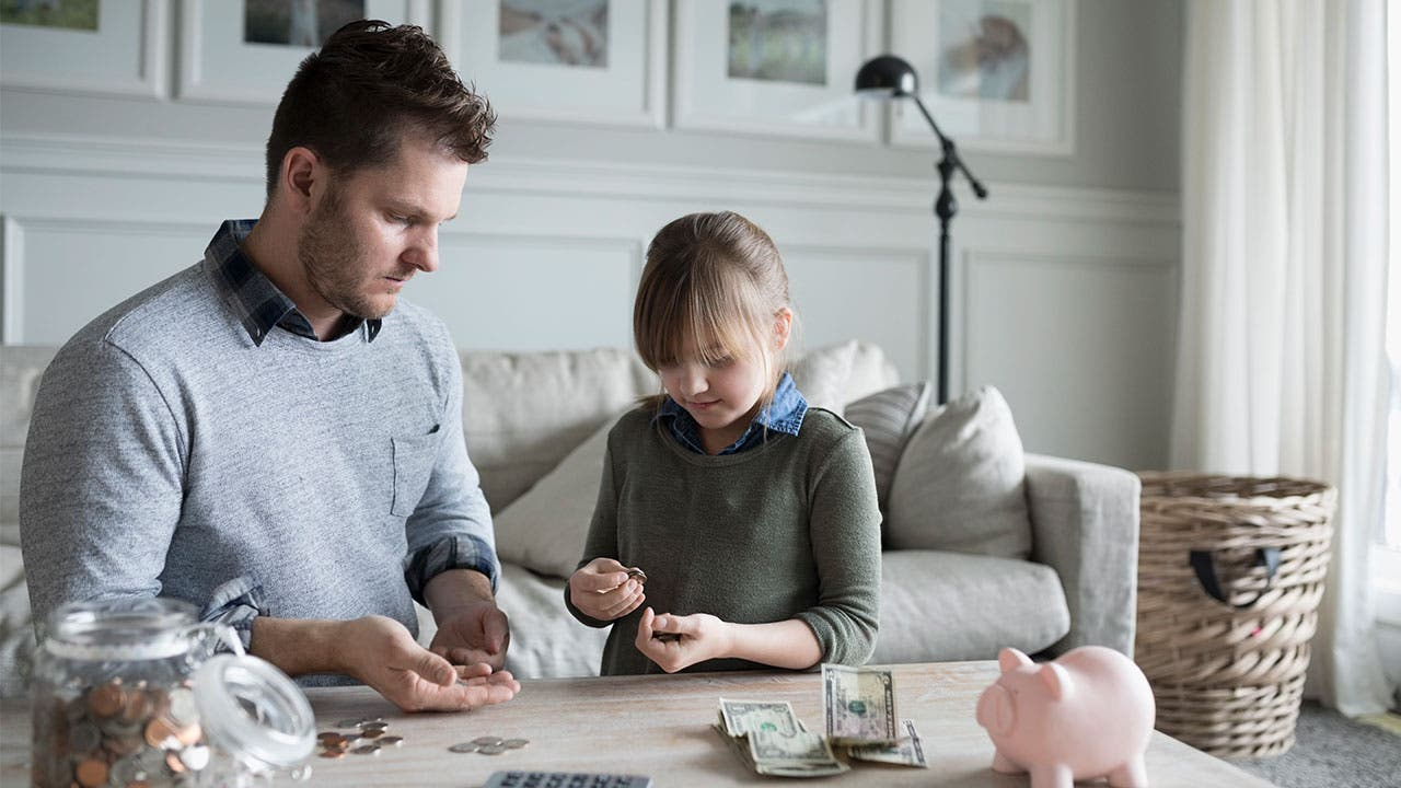 Father and daughter counting money