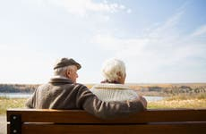 Older couple on park bench
