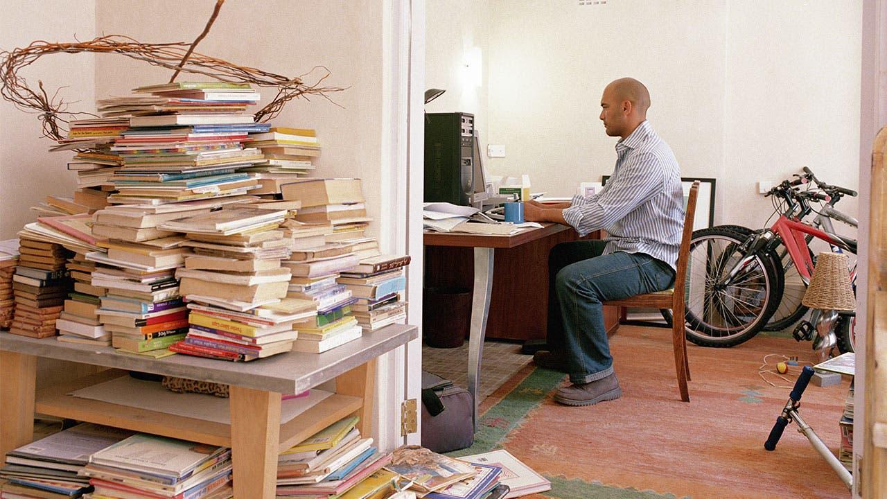 Man hoarding books
