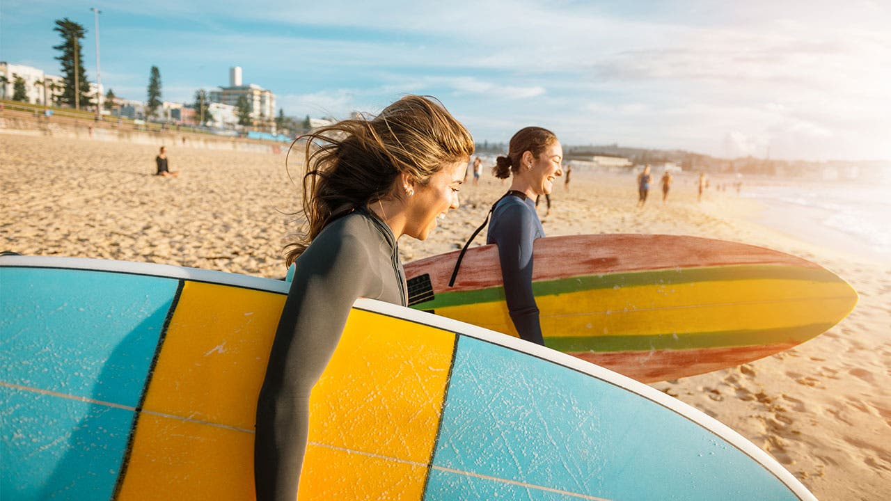 Two young women going surfing