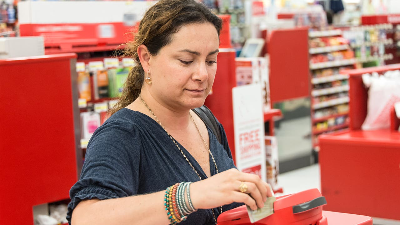 Woman shopping at Target paying with credit card