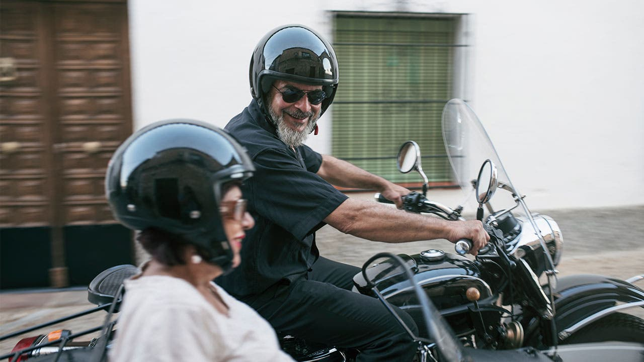 Older couple on motorcycle