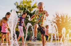 Kids playing in park fountain