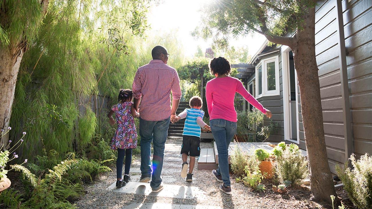 Family walking in driveway