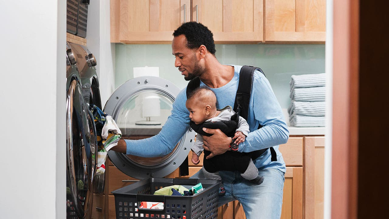 Father doing laundry with son