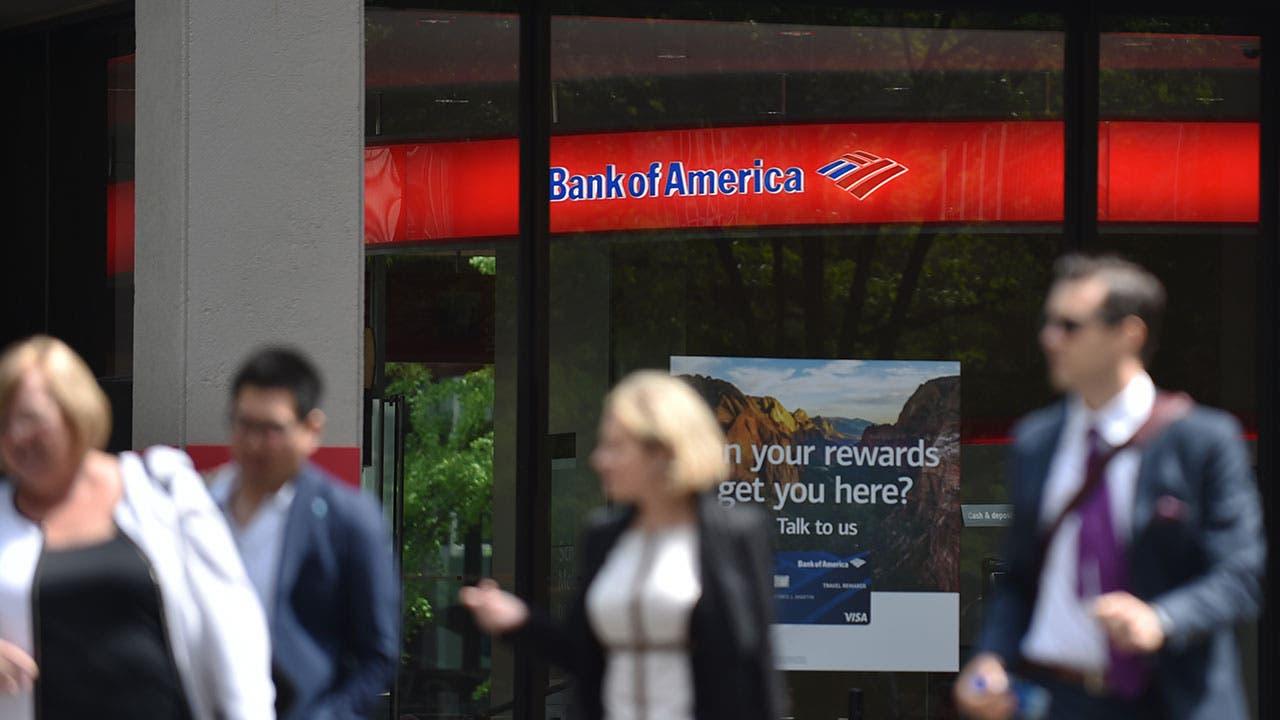 People walking by Bank of America