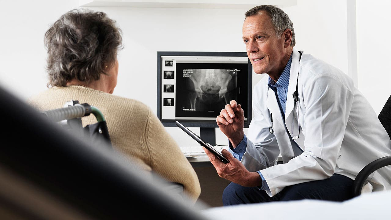 Doctor reviewing x-ray with patient