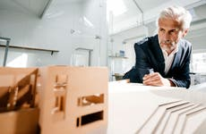 Man looking at architectural model