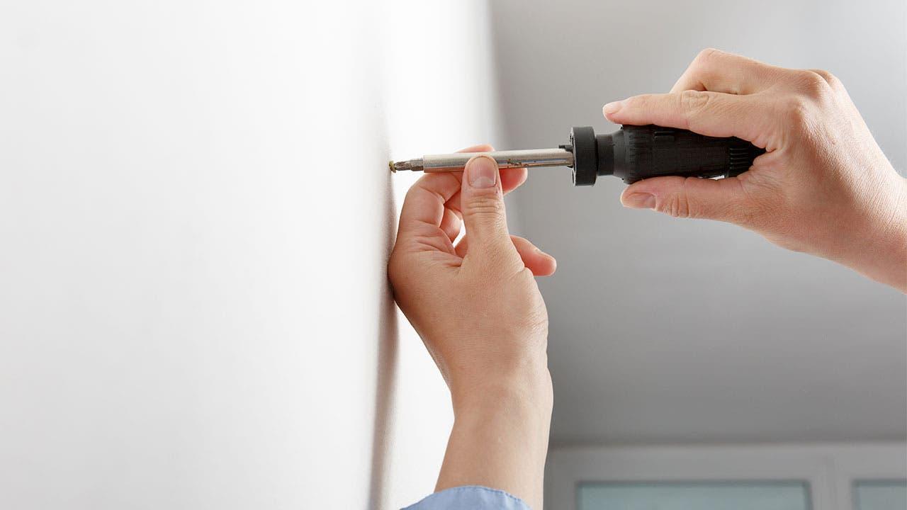 Woman using a screwdriver