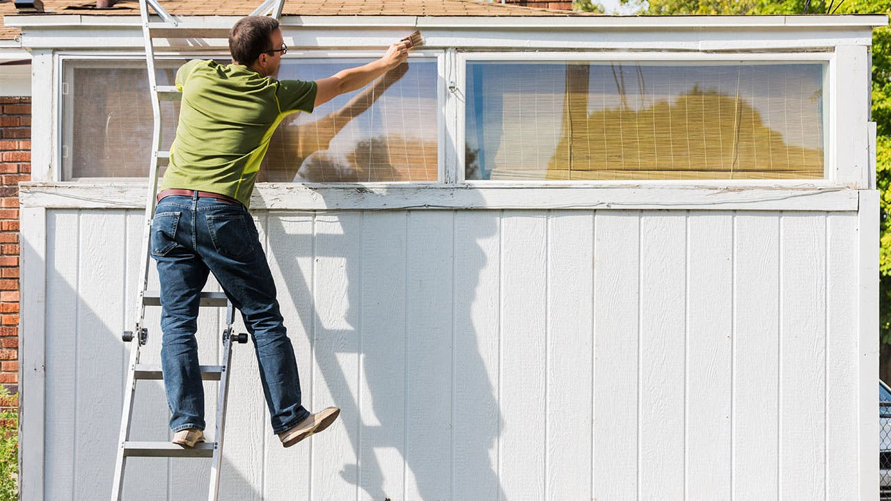 Man leaning on ladder