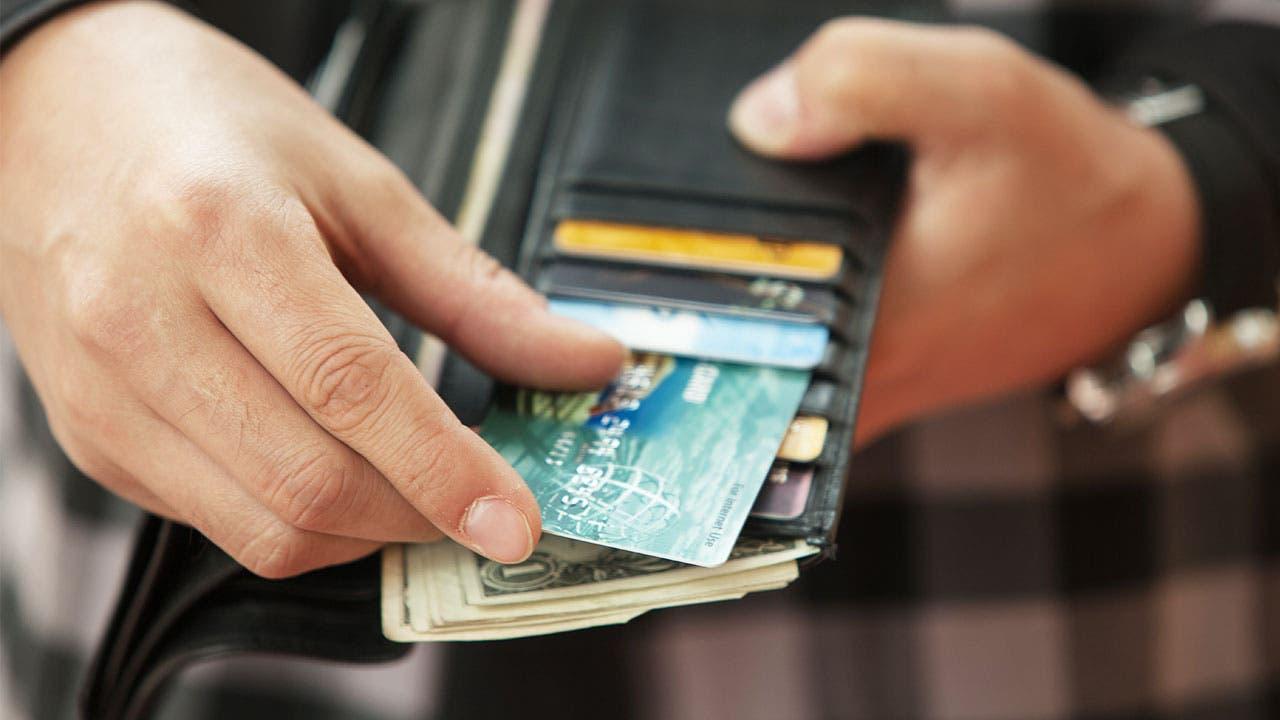 Man picking up a credit card