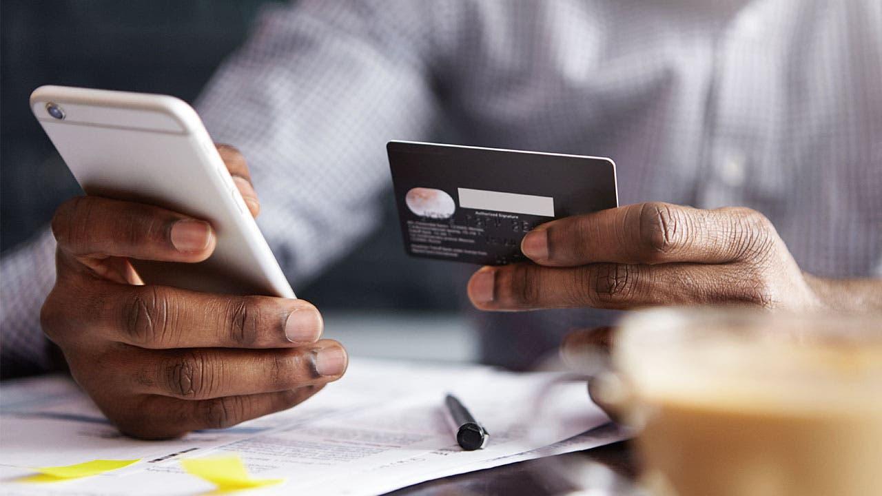 Man paying credit card