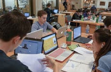 College students in a library study group