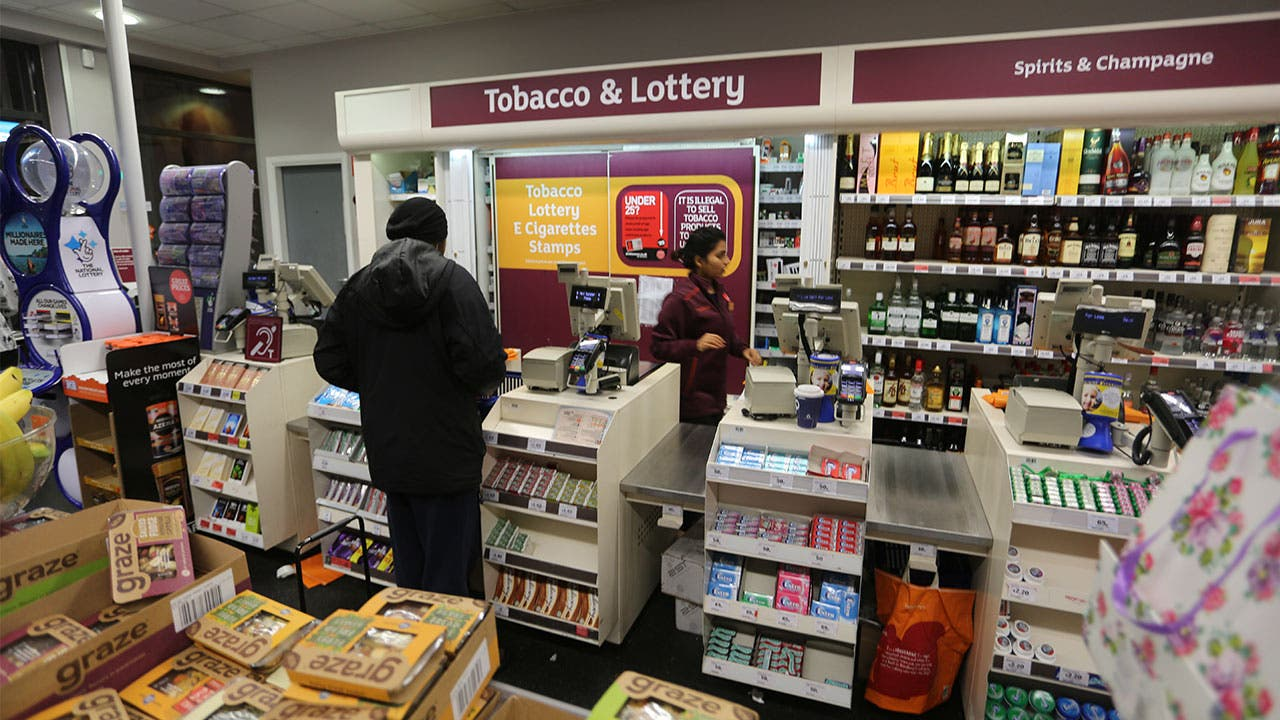 Man checking out at supermarket