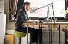 Man typing at desk