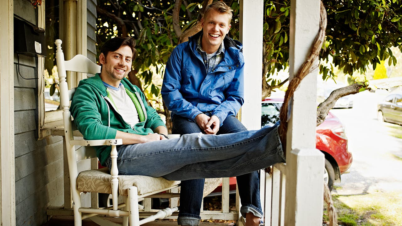 LGBT couple sitting on porch