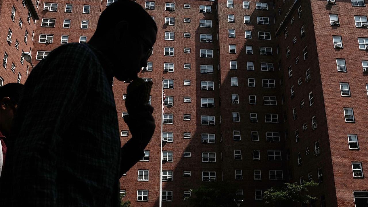 Man walking by public housing