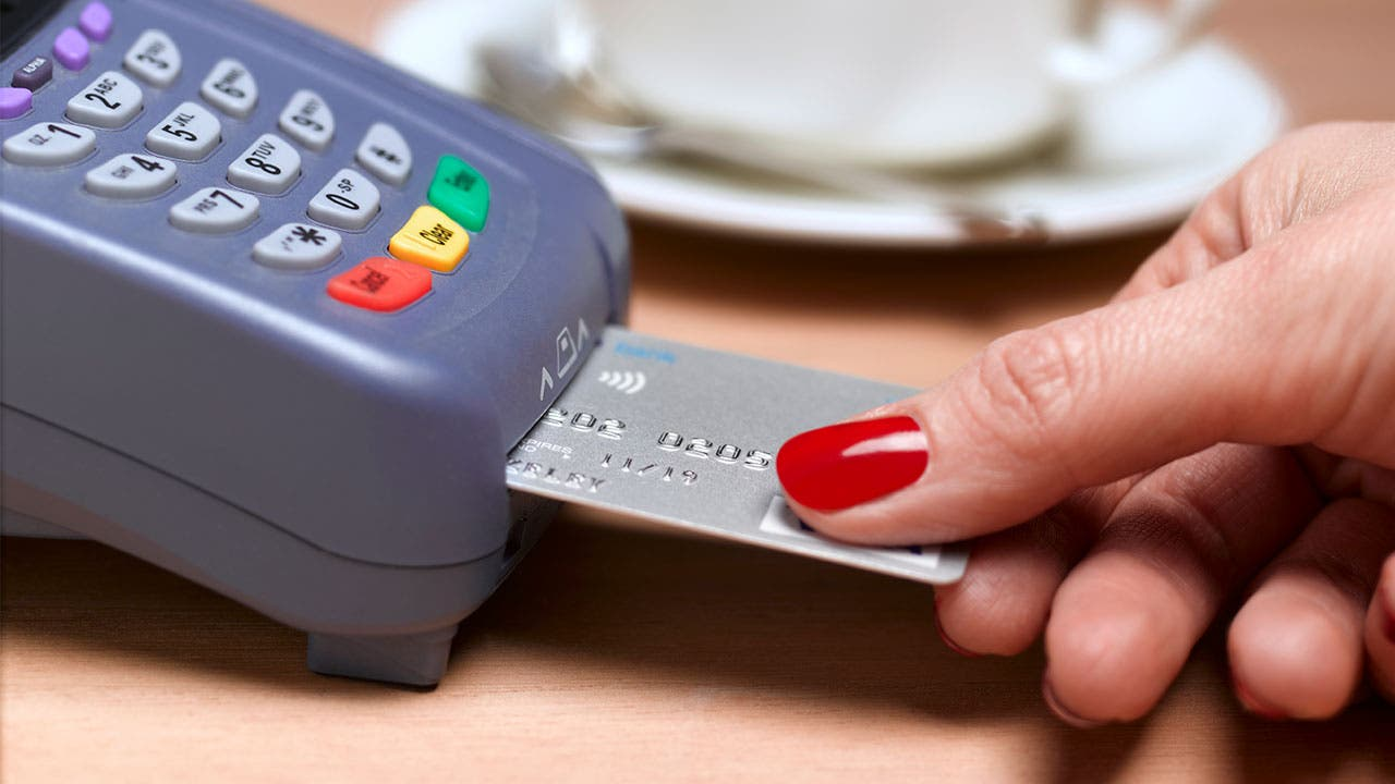 Woman using metal credit card