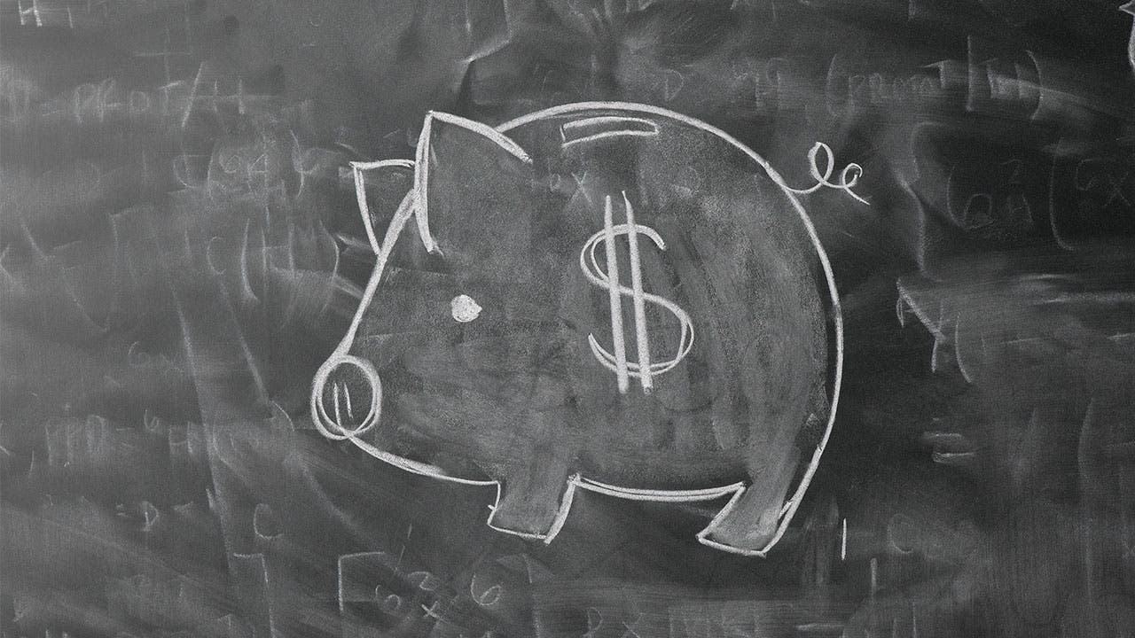 Piggy bank on a chalk board