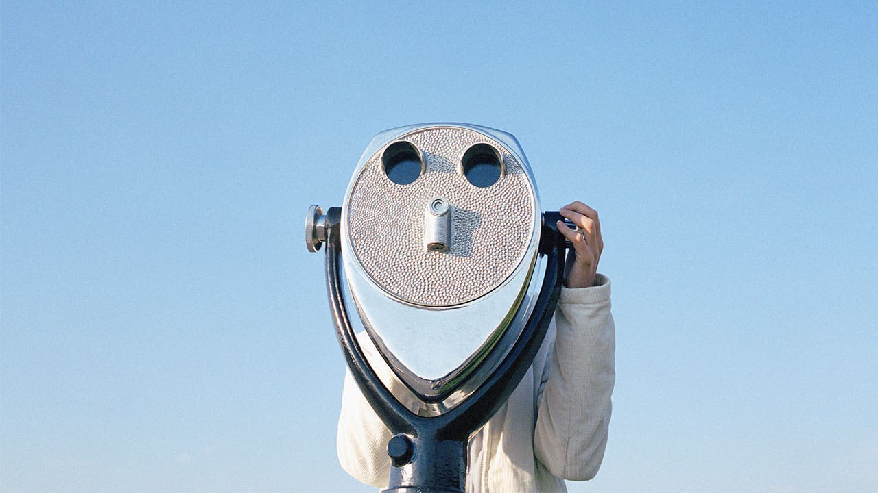 Man looking in a binoculars