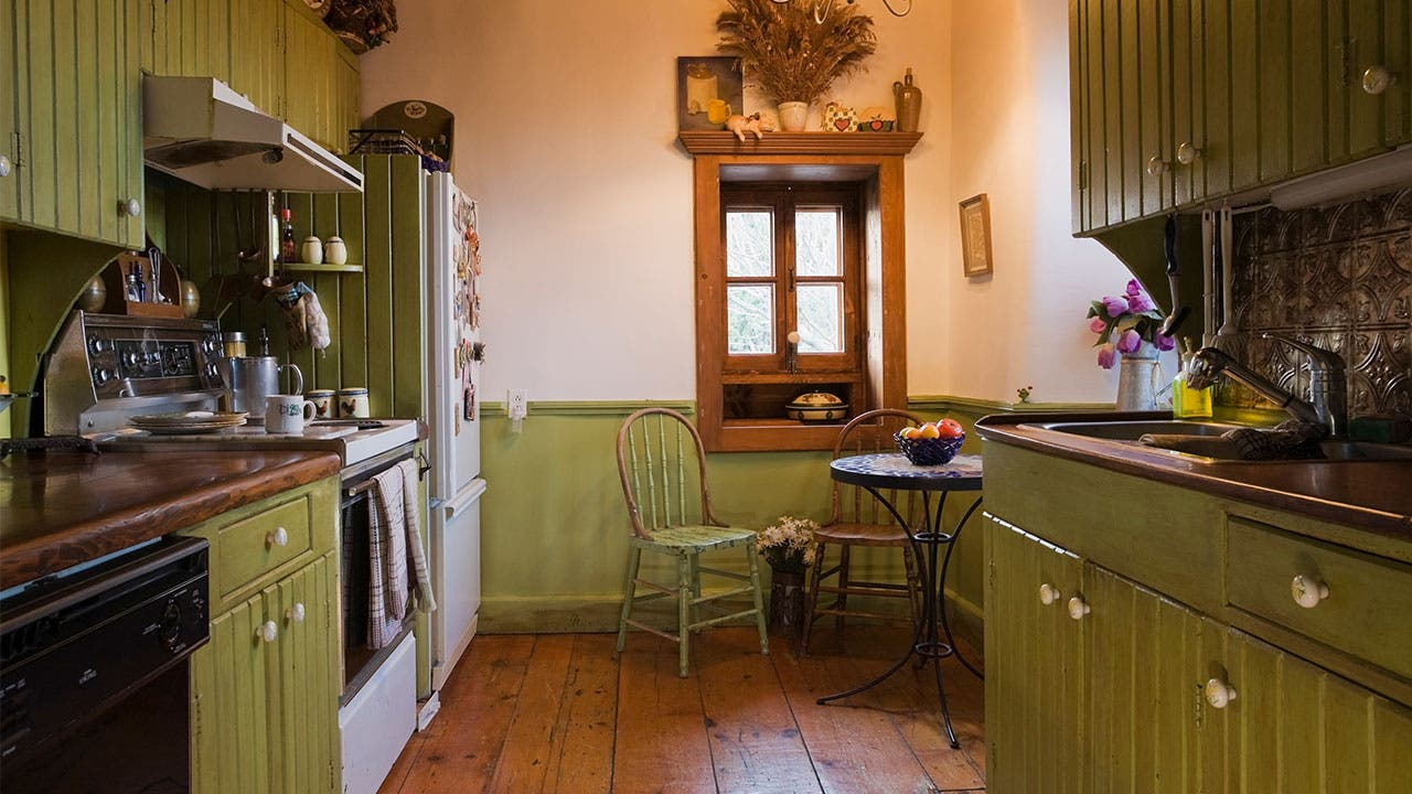 Dated kitchen with green cabinets