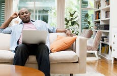 Man on laptop at home