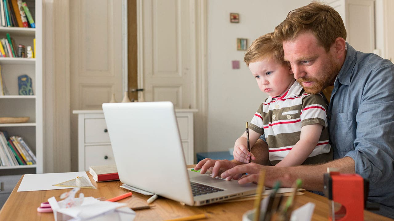 Father and son looking at laptop screen