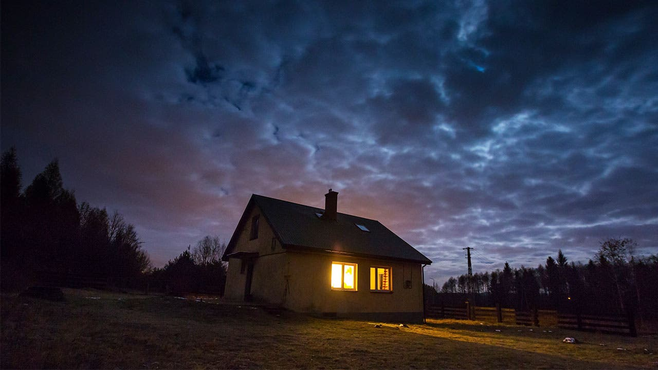 House with gloomy sky
