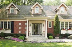 Brick home with landscaped front yard
