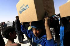 Children moving boxes of Unicef supplies