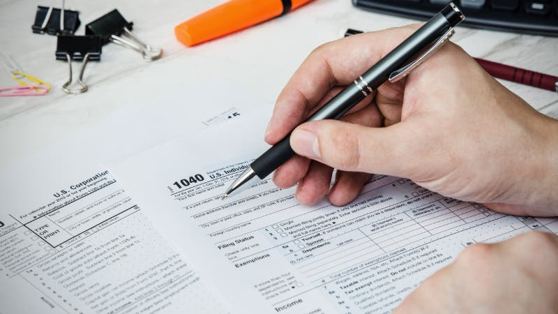 man filing tax form