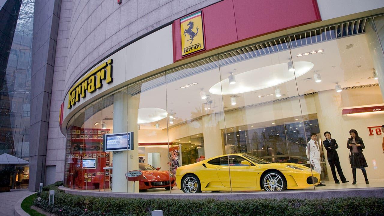 Ferrari dealership with customers