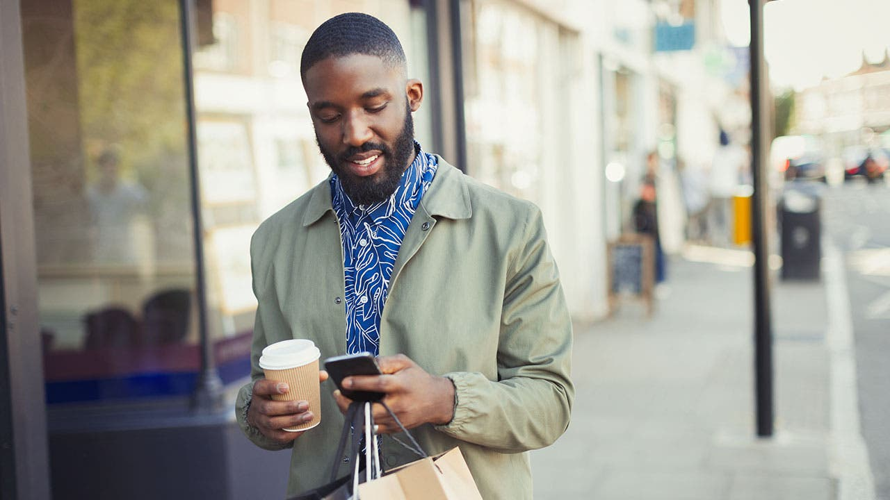 Man uses phone to check credit score