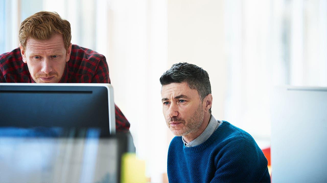Men looking at computer