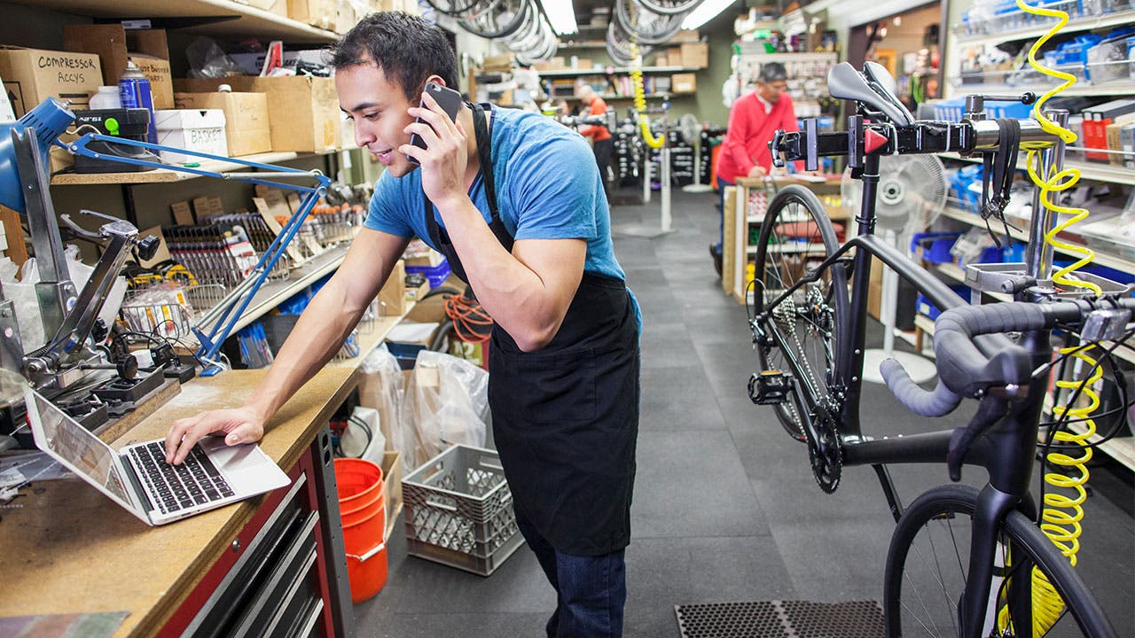 Latino man working in a bike shop