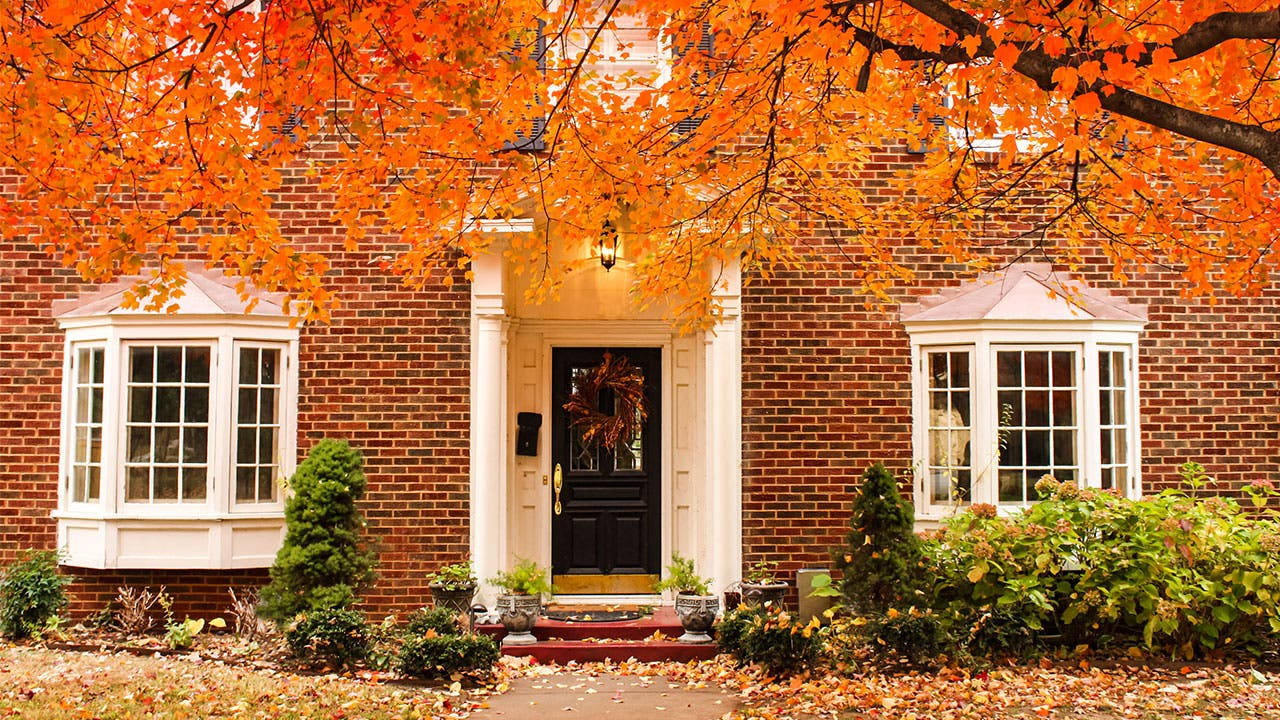 House with orange Fall leaves