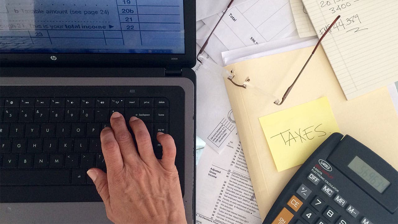 Man preparing taxes