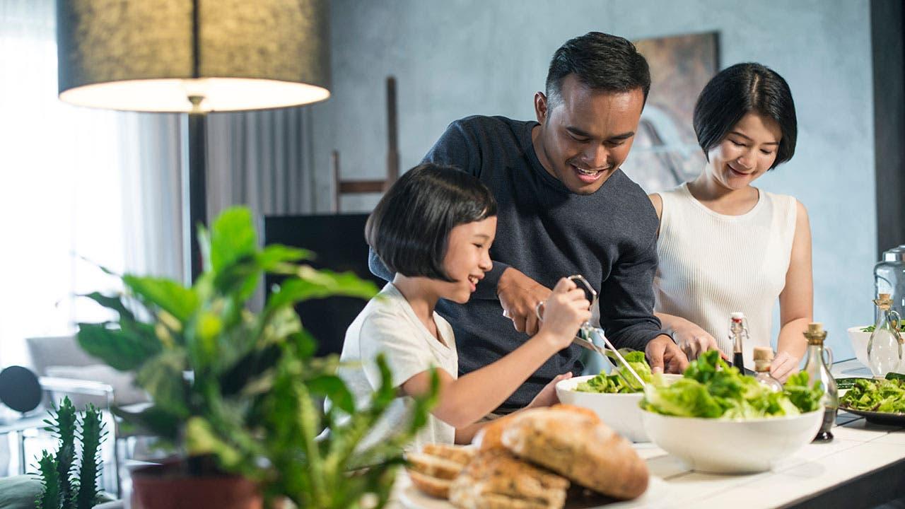 Family making salad together